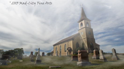 A historic Norwegian church is shrouded by mist in rural Dane County, WI near Madison.