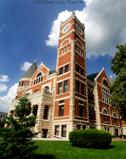 The historic Green County courthouse in Monroe, WI features a clock tower.