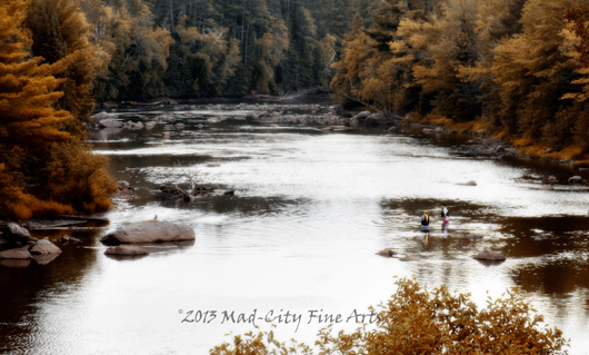 Two fishermen in the autumn landscape of the northwoods of Wisconsin, in Vilas county.